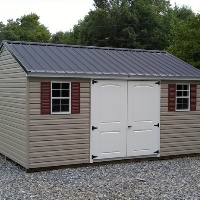 12x16 size vinyl a-roof style shed with black metal roof and 6 foot fiberglass doors with two windows