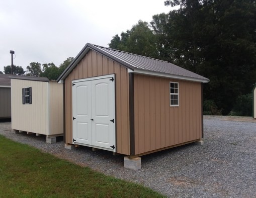 10x12 size Metal Classic style shed with Tan siding, burnished slate metal roof, 6 foot fiber doors with two windows