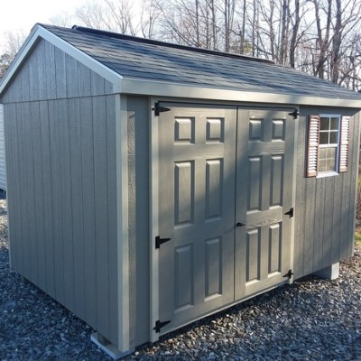 8x12 size a-roof style painted shingled shed with 6 foot fiberglass painted doors and one window on sale lot