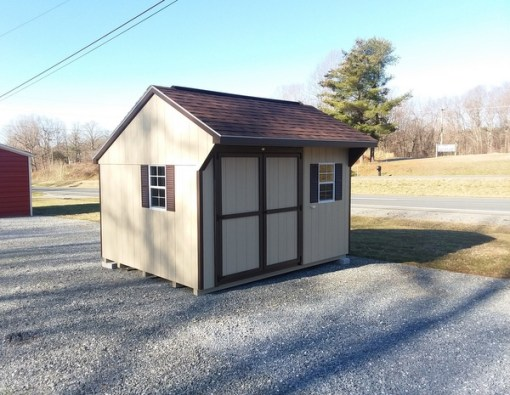 10 x 12 size painted carriage style shed with leola almond siding, brown trim, brownwood architectural shingle roof, brown shutters, 1 10' ridgevent, ggs 6 foot doors, two windows.