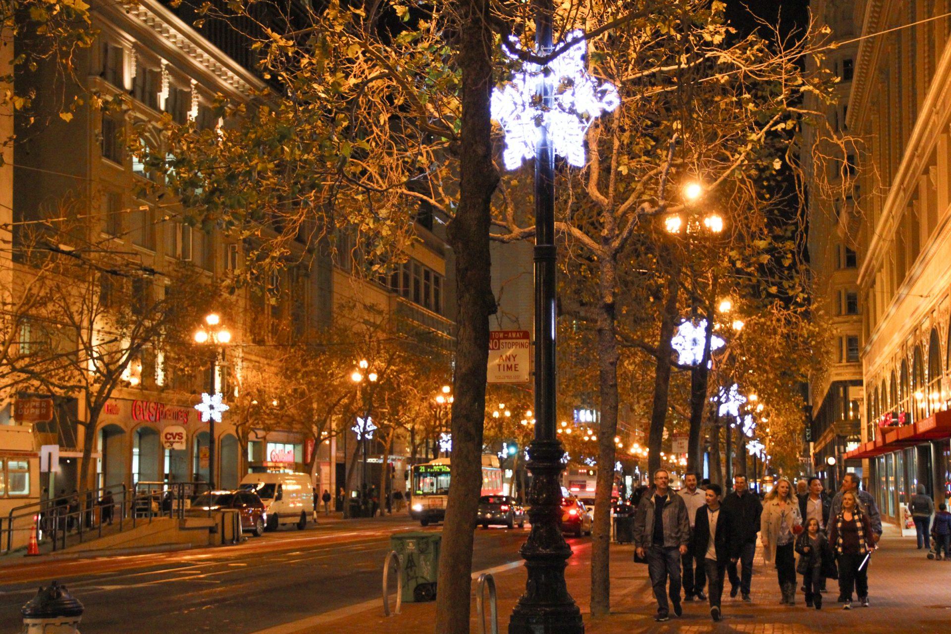 Free Stock Photo of People Walking Down City Street at Night