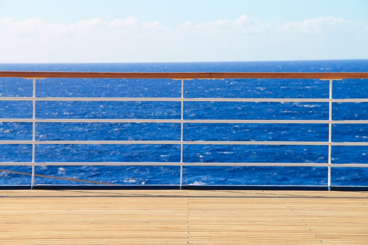 Railing & Deck of a Ship on the Ocean