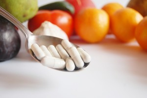 Image of a spoonfull of vitamin pills