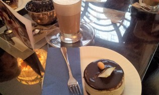 The Pistachio Cream Tart topped with Chocolate and a Café Latte