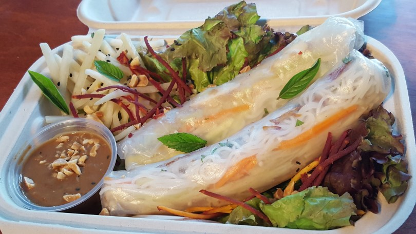 Vegan Spring Rolls Special: Fried tofu and shallots,* vermicelli, enoki, pickled cucumber, carrots,* cabbage, and herbs,* served with kefir lime daikon salad and fresh peanut sauce.*