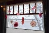 string of lights + paper flowers = DIY gold