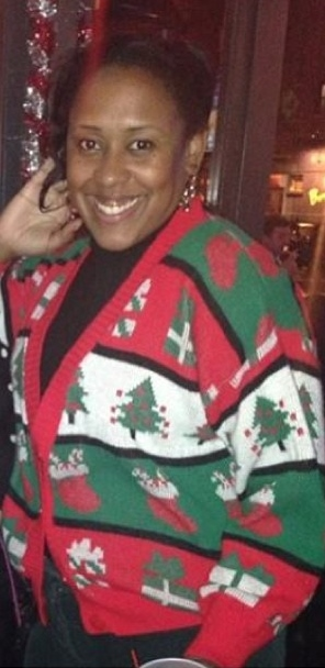 Shaunya wearing a red white and green Christmas themed sweater