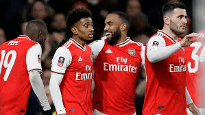 Arsenal Reiss Nelson celebrating with his teammates