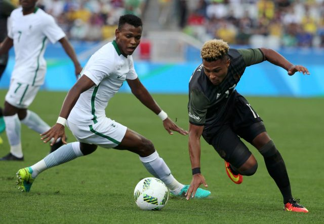 2016 Rio Olympics - Soccer - Semifinal - Men's Football Tournament Semifinal Nigeria v Germany - Corinthians Arena - Sao Paulo, Brazil - 17/08/2016. Abdullahi Shehu (NGR) of Nigeria and Serge Gnabry (GER) of Germany fight for the ball. REUTERS/Paulo Whitaker FOR EDITORIAL USE ONLY. NOT FOR SALE FOR MARKETING OR ADVERTISING CAMPAIGNS. Picture Supplied by Action Images