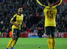 Arsenal's Theo Walcott and Alex Oxlade-Chamberlain celebrate