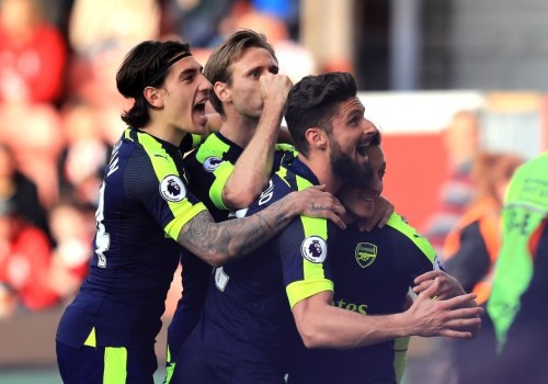 "Alt=""Arsenal celebrate during their 4-1 win over Stoke City"""