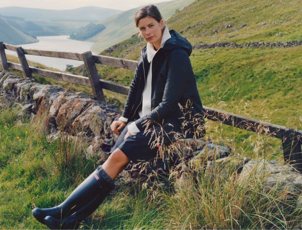 woman outside with Hunter boots