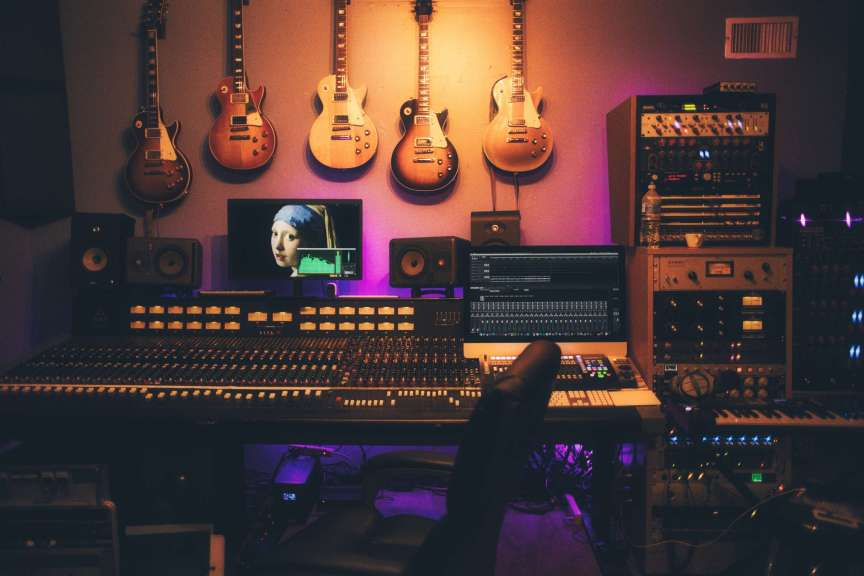 recording studio with guitars hanging on the wall