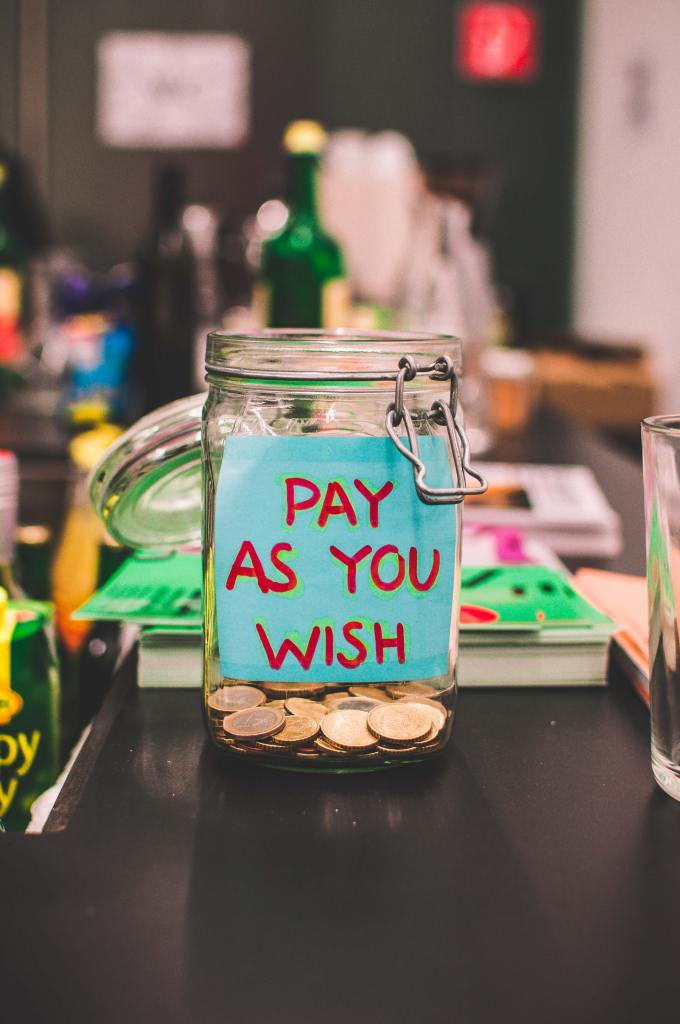 """tip jar with """"pay as you wish"""" written on the side"""