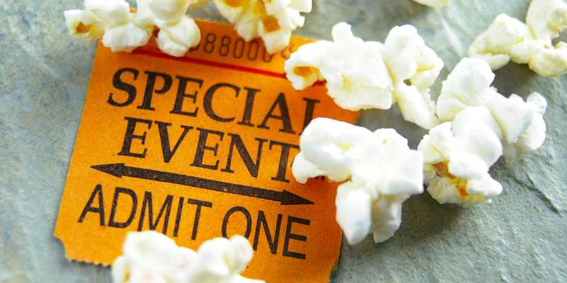 special event admit one ticket with popcorn spilled around it