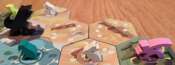 An image of an eagle set to its its prey in the Gods Love Dinosaurs board game