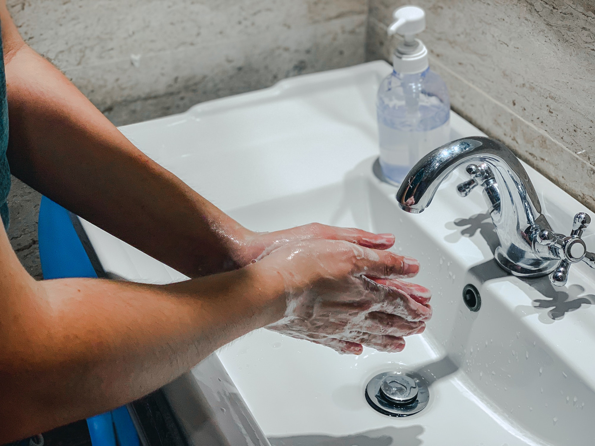 Coronavirus or Covid-19. Washing hands rubbing with soap man for corona virus prevention, hygiene to