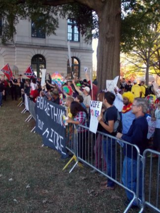 Supporters of the Latin American Coalition counter-protested the event. Some dressed in clown costumes and makeup.