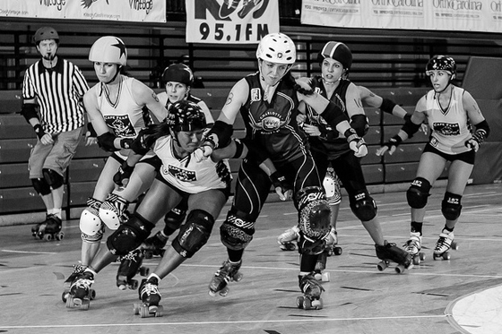 Charlotte Roller Girls jammin' it up against Cape Fear Roller Girls. Photo Credit: A Boy Named Tsunami