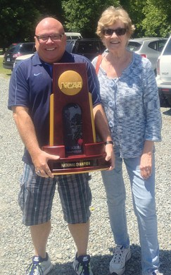 Dave Lohse, left, is all smiles as he shows off the 2013 NCAA Women's Lacrosse National Champion trophy with University of North Carolina-Chapel Hill  athletic department co-worker Glenda Jones.