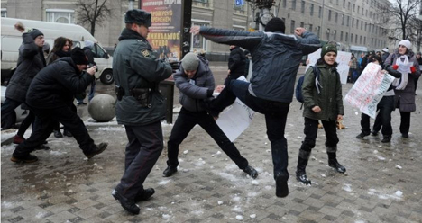 LGBT activist Pavel Lebedev is kicked by a counter-protester in Charlotte sister city, Voronezh, January 20, 2013. Photo Credit: Article20.org.