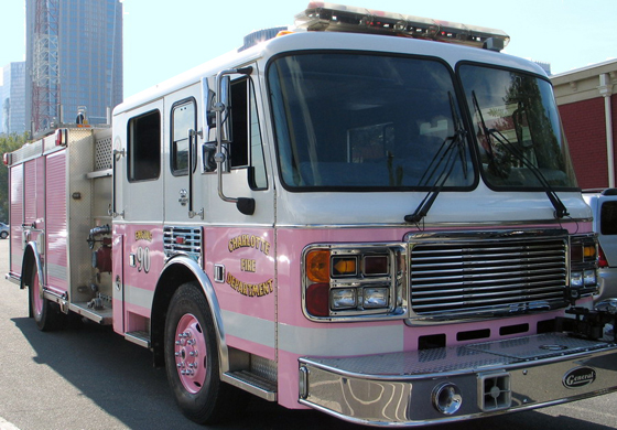 "On Tuesday, Sept. 27, 2011, the Charlotte Fire Department unveiled ""The Pink Lady,"" a reserve engine repainted pink just in time for the many events that promote breast cancer awareness. Breast cancer has touched the lives of many within the Charlotte community as well as members of the Charlotte Fire Department. The department says the truck is a way of showing solidarity and support for all those who have either directly or indirectly been affected by the disease. ""The Pink Lady"" made its official debut at the Susan G. Komen Race for the Cure on Oct. 1, 2011, and can still be seen at many events throughout the city.  Photo Credit: Charlotte Fire Department"