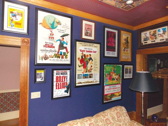 Original classic film art work fills their home.