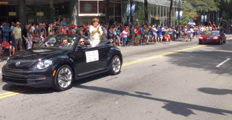 Charlotte Mayor Patsy Kinsey rides in the Aug. 25, 2013, Bank of America Charlotte Pride Parade, with City Councilmember LaWana Mayfield following.