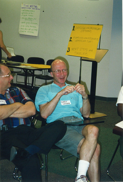 Gary Spann discusses ideas in this undated photograph from a community center planning meeting.