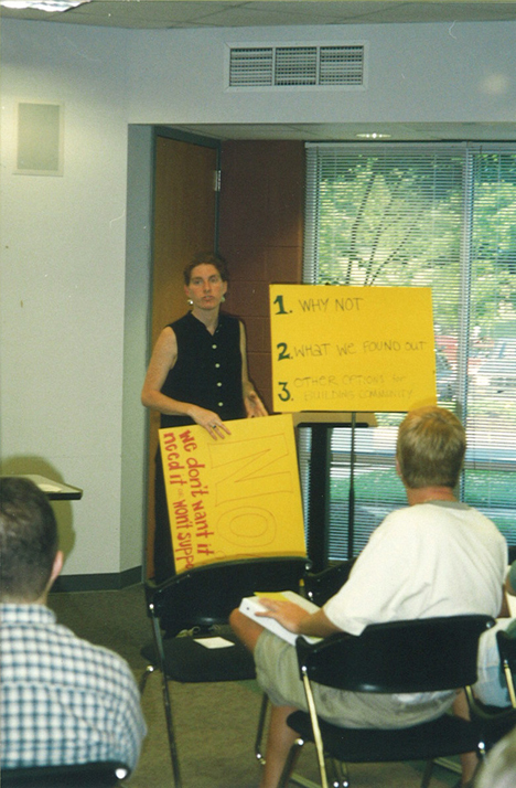 A leader facilitates discussion in this undated photograph from a community center planning meeting.