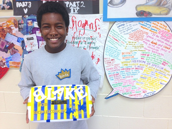 East Mecklenburg senior Blake Brockington holds the fundraising box that will determine if he becomes homecoming king on Friday.