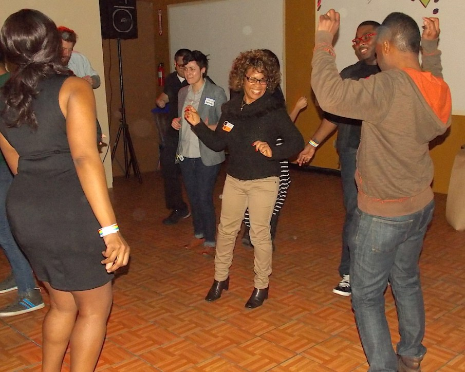 Center board member Crystal Long, center, dances with center supporters and community members during their 'Back to the Block' fundraising event.