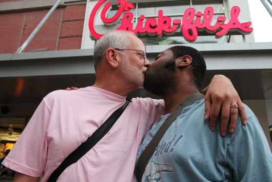 "A couple kisses during the ""National Same-Sex Kiss-In Day"" on Aug. 3, 2012, at a Silver Spring, Md., Chick-fil-A. Photo Credit: Elvert Barnes, via Flickr. Licensed CC."