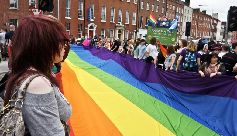"Charlotte St. Patrick's Day Parade organizers say they forbid the rainbow flag in order to celebrate ""Irish culture."" Pictured here: Yes, it's real, live LGBT Irish people in Dublin, holding a rainbow flag before the start of Dublin Pride. Photo Credit: William Murphy, via Flickr. Licensed CC."