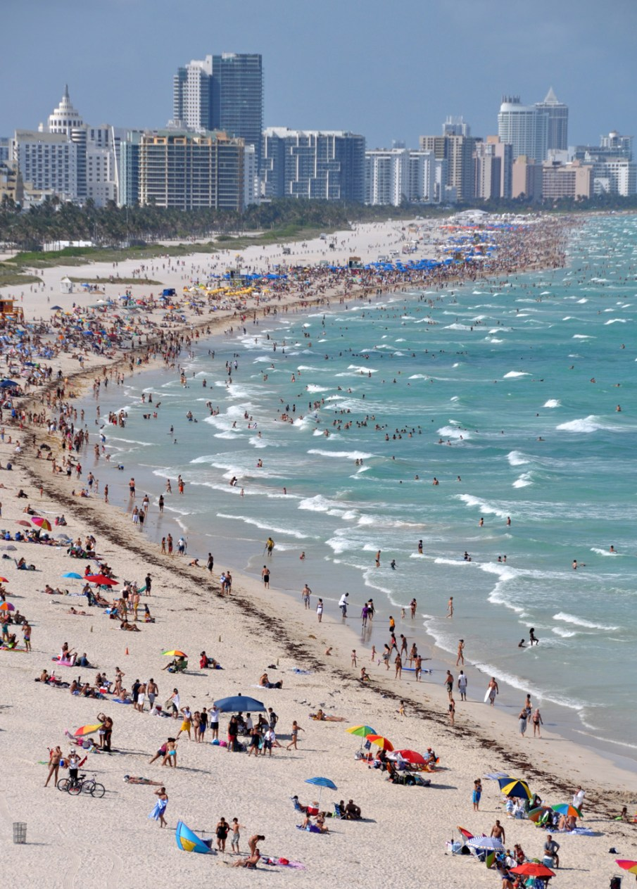 Visitors flock to Florida's South Beach for fun, sun, sand and water.  Photo Credit: James Willamor, via Flickr. Licensed CC.