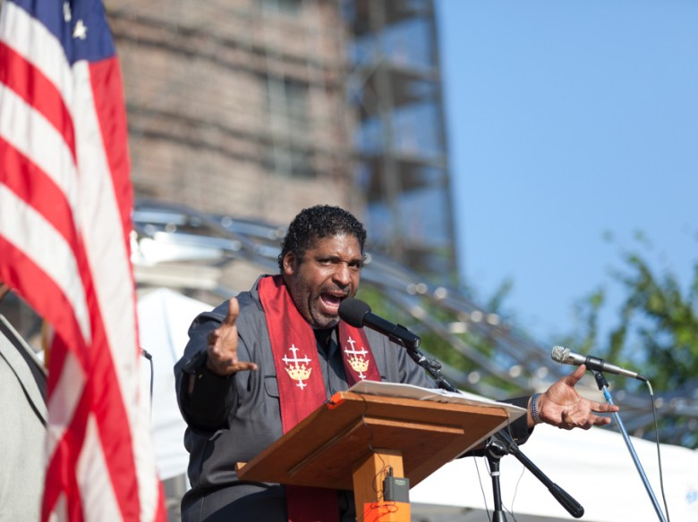 NAACP of North Carolina's Rev. William Barber III at a Moral Mondays gathering in Asheville. Photo Credit: Will Thomas, via Flickr. Licensed Creative Commons.