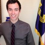 Hagan hires gay spokesperson