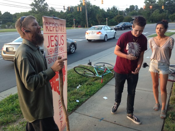 A protester preaches outside the LGBT Community Center of Charlotte.