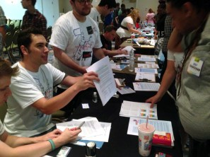 Volunteers with the LGBTQ Law Center assist attendees with creating healthcare power of attorney agreements.