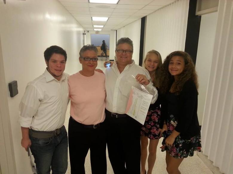Glenda Lawson and Julie Treadway with their children after receiving their marriage license. Photo Credit: Cameron Joyce.