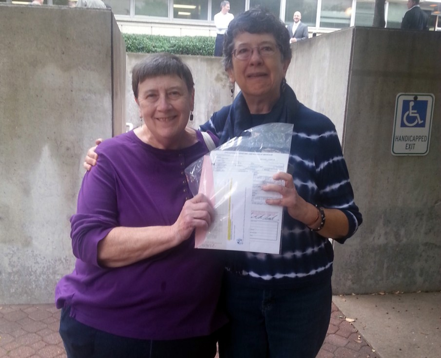 """Both in their 60s, Jannet Hince and Donna Travis have been together for 35 years, waiting for the day when their home state might finally and legally recognize their relationship. Like others, they'd considered going out of state, but had been """"dragging our feet hoping this would happen,"""" Hince said. Unfortunate events over the weekend forced their hands the morning of Oct. 13. """"A friend of ours unexpectedly died Saturday night and it made us realize we don't want to wait,"""" Hince said. """"We've waited 38 years. It's time."""" Travis added: """"We deserve it after all these years."""" (C.J.) Photo Credit: Cameron Joyce"""