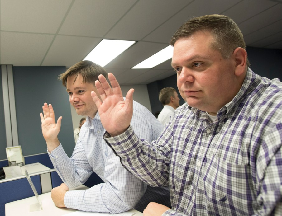 Jerry Read, left, and Thom Hall, right, finalize the process to receive their marriage license in Mecklenburg County on the morning of Oct. 13. Photo Credit: Jennifer Hogan  (hoganimaging.com)