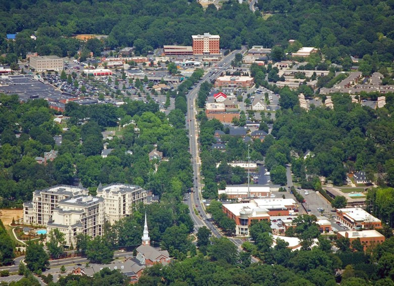 A look at Cotswold from the air. The central business area and shopping center hosting Harris Teeter is located in the top left of the photo. Photo Credit: Bz3rk, via Wikimedia. Licensed CC.