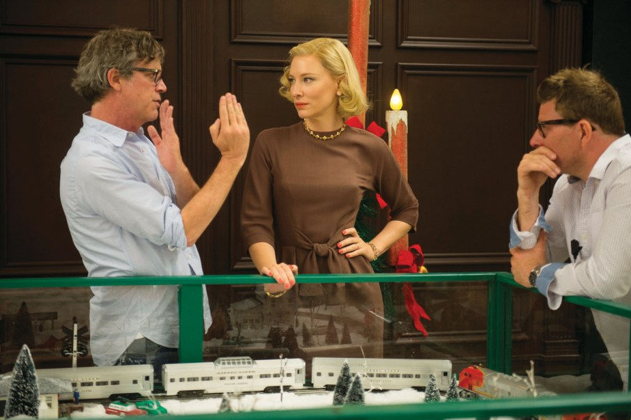 Director Todd Hayes (left) discusses and blocks a scene on set with 'Carol' cast and crew. Photo Credit: The Weinstein Company