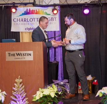 Wells Fargo, Corporate Partner of the Year, accepted by Brian Adcox (presented by Jason Morton, chair, Membership Experience)
