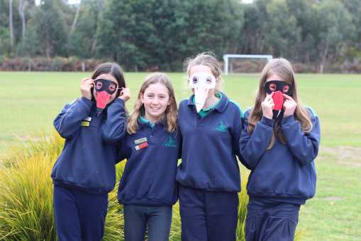 Students proudly display their newly created Hooded Plover masks.
