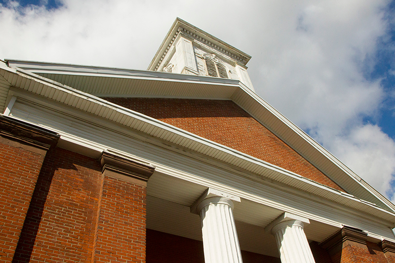 The front facade  of the Reformed Church features a portico with twin sets of flanking brick pilasters and a central pair of fluted Doric order columns in Port Richmond section of Staten Island, N,Y. on Friday Oct. 25, 2013. (Gordon Donovan)