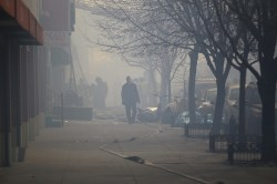 An emergency responder makes his through the smoke on 116th street in the Harlem section of New York City, after an explosion that took down two buildings March 12, 2014. (Gordon Donovan/Yahoo News)