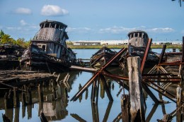 Making your way out to photograph these old two old wooden tug boats is very dangerous. The wooden piers are been the victim of fire and age. The spikes used to built the piers are visible. (Gordon Donovan)