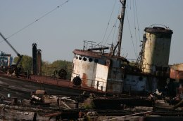 Several retired vessels wait to be scrapped in a junkyard in the Rossville section of Staten Island. (Gordon Donovan)